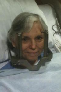 "With a ""crown"" drilled into her head and ready to go into brain surgery, Momma still managed to snap a picture of herself to me letting me see that she was smiling and ok."