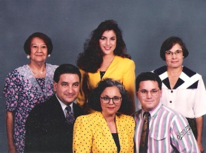 This was our family photo that was used in our Church directory. Sissy is standing on the right. I'm beside her in yellow. Momma and I wore matching suits.