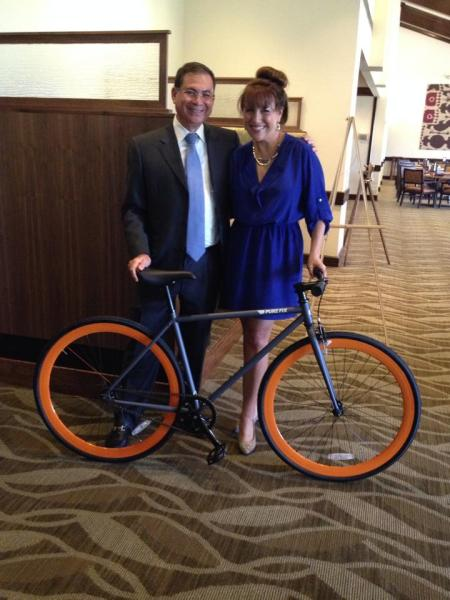 Fabulous fixie with orange wheels donated by Wally's Bike Shop for our auction!!!